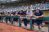 Michigan Wolverines non roster players Ben Dragani, Dillon Nowicki, Danny Zimmerman, Jack Van Remortel, Jordon Rogers and Keaton Carratini in the dugout before  Game 2 of the NCAA College World Series Finals on June 25, 2019 at TD Ameritrade Park in Omaha, Nebraska. Vanderbilt defeated Michigan 4-1. (Andrew Woolley/Four Seam Images)