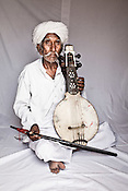 75-year-old Manganiyar artist and a Padmashree awardee, Saqar Khan poses for a portrait inside his house in Hamira village of Jaiselmer district in Rajasthan, India. Photo: Sanjit Das/Panos