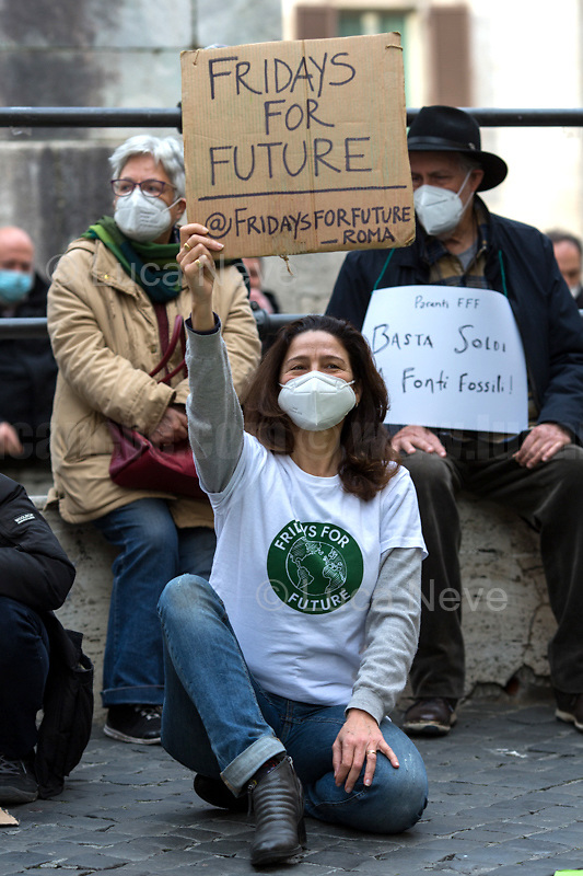 """Rome, Italy. 19th Feb, 2021. Today, Fridays For Future Roma (1.) held a sit-in outside the Italian Parliament in Piazza Montecitorio called """"The Transition We Want"""". The aim of the rally was to call the new Italian Government, led by Professor Mario Draghi, to act for an immediate plan, investments and policies against the so called """"climate changes"""" and the consequent climate crisis. The """"Fridays for Future"""" actions are a series of global demonstrations directly related to Greta Thunberg (2.), the 16 year old """"Swedish political activist seeking to stop global warming and climate change, [who] in August 2018 became a prominent figure for starting the first school strike for climate, outside the Swedish parliament building"""" (source Wikipedia.org, 3.). <br /> <br /> Footnotes & Links:<br /> 1. https://facebook.com/FFFroma  <br /> 2. @GretaThunberg (Personal Twitter page - No Personal Website available) <br /> 3. https://en.wikipedia.org/wiki/Greta_Thunberg"""