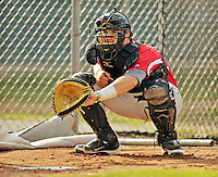 19 July 2012: Tri-City ValleyCats catcher Mike Cokinos warms up prior to a game against the Vermont Lake Monsters at Centennial Field in Burlington, Vermont. The ValleyCats defeated the Lake Monsters 6-3 in NY Penn League action. Mandatory Credit: Ed Wolfstein Photo