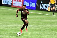 ATLANTA, GA - APRIL 27: Atlanta United defender #21 George Bello dribbles the ball during a game between Philadelphia Union and Atlanta United FC at Mercedes-Benz Stadium on April 27, 2021 in Atlanta, Georgia.