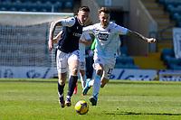24th April 2021; Dens Park, Dundee, Scotland; Scottish Championship Football, Dundee FC versus Raith Rovers; Jordan McGhee of Dundee goes past Brad Spencer of Raith Rovers