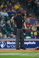 Home plate umpire Ken Langford makes a strike call during the NCAA baseball game between the Oklahoma Sooners and the LSU Tigers in game seven of the 2020 Shriners Hospitals for Children College Classic at Minute Maid Park on March 1, 2020 in Houston, Texas. The Sooners defeated the Tigers 1-0. (Brian Westerholt/Four Seam Images)