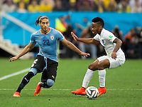 Martin Caceres of Uruguay and Raheem Sterling of England