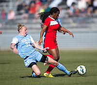 Hanna Gardner (71) of North Carolina tries to tackle Tiffany McCarty (14) of the Washington Spirit during the game at the Maryland SportsPlex in Boyds, MD.  The Washington Spirit defeated the North Carolina Tar Heels in a preseason exhibition, 2-0.
