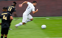 LOS ANGELES, CA - OCTOBER 25: Sebastian Lletget #17 of the Los Angeles Galaxy runs with the ball during a game between Los Angeles Galaxy and Los Angeles FC at Banc of California Stadium on October 25, 2020 in Los Angeles, California.
