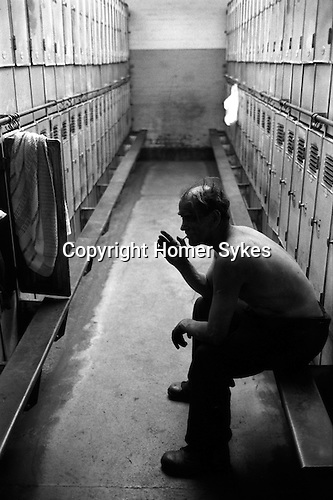 Snowdown Colliery, Snowdown Kent. Miner has come off a shift, in locker room having a smoke before washing and going home 1976. UK  December 1976.