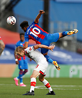 12th September 2020; Selhurst Park, London, England; English Premier League Football, Crystal Palace versus Southampton; Wilfried Zaha of Crystal Palace heads the ball over James Ward-Prowse of Southampton