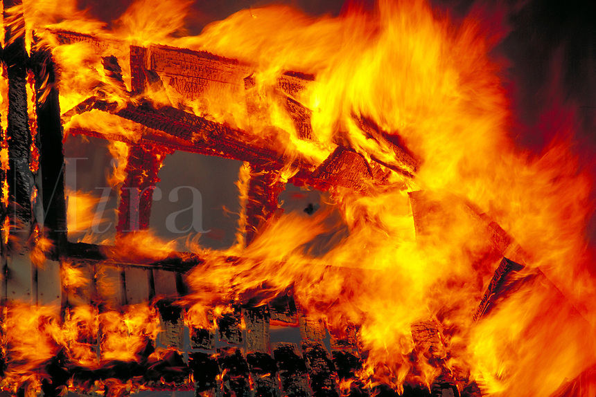 Building on fire engulfed in flames and smoke.