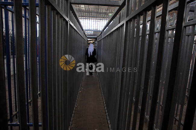 Palestinian man passes through a gate at Qalandia checkpoint between the West Bank city of Ramallah and Jerusalem, Monday, March 29, 2010. Israel imposed a closure on the West Bank as a security measure for the duration of the weeklong Passover holiday. The routine measure bars almost all Palestinians from entering Israel. Photo by Issam Rimawi