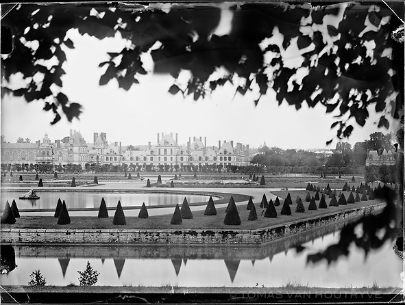 The Chateau de Fontainebleau (Palace of Fontainebleau) is seen from the south side in France. The castle is surrounded by forest, which was the preferred hunting grounds of the French monarchy. It served as a royal residence from Louis VII to Napoleon III. After serving as a soldier in Napoleon's war and being injured a military campaign in Spain, Claude François Denecourt was put in charge of a barracks in Fontainebleau in 1830. According to historian Jean-Claude Polton, he became depressed until he started exploring the surrounding forest, which he fell in love with.