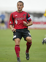 26 June 2004:   Dallas Burn Jason Kreis in action against DC United at Cotton Bowl in Dallas, Texas.   DC United and Dallas Burn are tied 1-1 after the game.   Credit: Michael Pimentel / ISI
