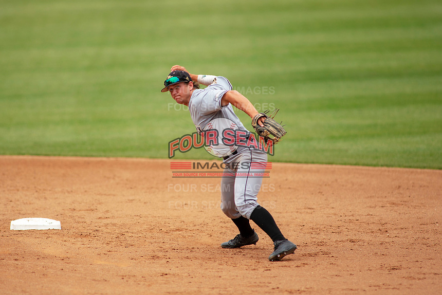 Cal Poly San Luis Obispo Mustangs Kyle Marinconz (4) makes a throw to first base against the UC-Riverside Highlanders at Riverside Sports Complex on May 26, 2018 in Riverside, California. The Cal Poly SLO Mustangs defeated the UC Riverside Highlanders 6-5. (Donn Parris/Four Seam Images)
