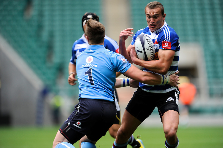 Carel du Preez of DHL Western Province forces his way past Jan-Frederik Enslin of Blue Bulls during the World Club 7s at Twickenham on Sunday 18th August 2013 (Photo by Rob Munro)