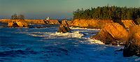 972500006 panoramic view of sunset light on the cape arago lighthouse and the coastal seamounts along the central pacific coast of oregon