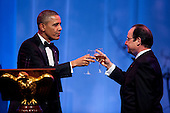 United States President Barack Obama and President Francois Hollande of France toast each other at the beginning of the State Dinner in Hollande's honor in Washington, District of Columbia, U.S., on Tuesday, Feb. 11, 2014.  After an arrival ceremony on the South Lawn, Obama and Hollande met in the Oval Office for a policy meeting then gave a joint press conference in the East Room of the White House. <br /> Credit: Pete Marovich / Pool via CNP