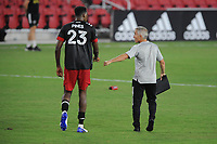 WASHINGTON, DC - AUGUST 25: Donovan Pines #23 of D.C. United with Richie Williams New England Revolution Assistant Head Coach during a game between New England Revolution and D.C. United at Audi Field on August 25, 2020 in Washington, DC.