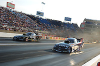Jun. 30, 2012; Joliet, IL, USA: NHRA funny car driver Tony Pedregon (right) races alongside Dale Creasy Jr during qualifying for the Route 66 Nationals at Route 66 Raceway. Mandatory Credit: Mark J. Rebilas-