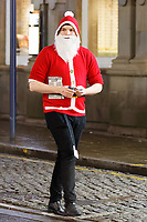 A young man dressed as Santa in Wind Street, Swansea, Wales  on Mad Friday, Booze Black Friday or Black Eye Friday, the last Friday night before Christmas Day, when traditionally people in the UK go out to celebrate the start of their holidays. Friday 22 December 2017