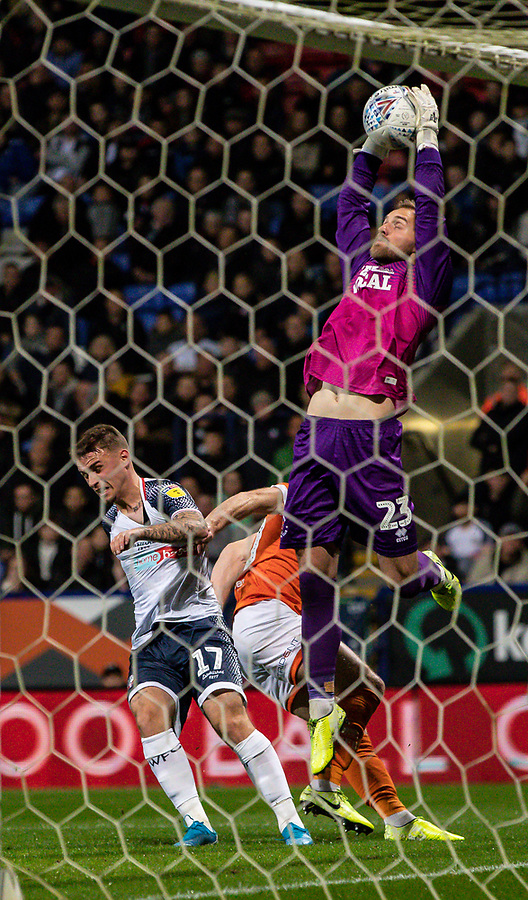 Blackpool's goalkeeper Jak Alnwick saves under pressure from Bolton Wanderers' Thibaud Verlinden (left) <br /> <br /> Photographer Andrew Kearns/CameraSport<br /> <br /> The EFL Sky Bet League One - Bolton Wanderers v Blackpool - Monday 7th October 2019 - University of Bolton Stadium - Bolton<br /> <br /> World Copyright © 2019 CameraSport. All rights reserved. 43 Linden Ave. Countesthorpe. Leicester. England. LE8 5PG - Tel: +44 (0) 116 277 4147 - admin@camerasport.com - www.camerasport.com