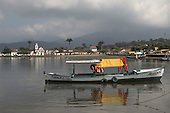 "Paraty, Rio de Janeiro, Brazil. Colonial seaside port town with baroque church of Santa Rita and ""Marisol"", a wooden launch"