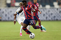 KANSAS CITY, KS - JULY 15: George Bello #21 of the United States moves with the ball during a game between Martinique and USMNT at Children's Mercy Park on July 15, 2021 in Kansas City, Kansas.