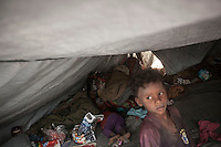 Thursday 16 July, 2015: Displaced children from the heavy fighting and bombarments in Sa'dah governorate and Haradh bordertown are seen inside a tent in a temporary settlement in the outskirts of Khamer city in the Amran province of Yemen. (Photo/Narciso Contreras)