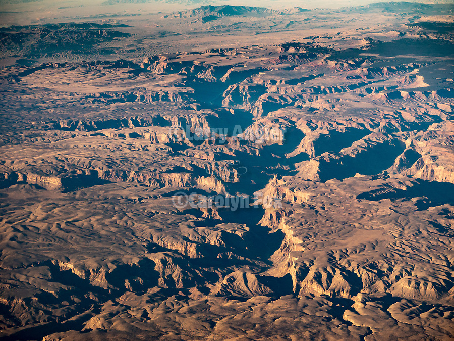 Canyons west of the Grand Canyon, Arizona, from a window seat on a United Airlines flight from Chicago to Los Angeles over America's Flyover County.