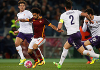 Calcio, Serie A: Roma vs Fiorentina. Roma, stadio Olimpico, 4 marzo 2016.<br /> Roma's Mohamed Salah, second from left, is challenged by Fiorentina's Marcos Alonso, left, Gonzalo Rodriguez and Davide Astori, right, during the Italian Serie A football match between Roma and Fiorentina at Rome's Olympic stadium, 4 March 2016.<br /> UPDATE IMAGES PRESS/Riccardo De Luca