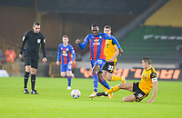 8th January 2021; Molineux Stadium, Wolverhampton, West Midlands, England; English FA Cup Football, Wolverhampton Wanderers versus Crystal Palace; Morgan Gibbs White of Wolverhampton Wanderers comes in for a sliding tackle on Christian Benteke of Crystal Palace as he breaks forward with the ball at his feet