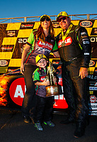 Oct 29, 2017; Las Vegas, NV, USA; NHRA top fuel driver Terry McMillen celebrates with wife Cori McMillen and son Cameron McMillen after winning the Toyota National at The Strip at Las Vegas Motor Speedway. Mandatory Credit: Mark J. Rebilas-USA TODAY Sports