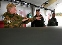 Squadron leader Hans Petter Narmo talks to colleagues  of 717 squadron about an incident. 717 squadron operates DA-20 Jet Falcon. Royal Norwegian Air Force. BOLD AVENGER 2007 (BAR 07), a NATO  air exercise at Ørland Main Air Station, Norway. BAR 07 involved air forces from 13 NATO member nations: Belgium, Canada, the Czech Republic, France, Germany, Greece, Norway, Poland, Romania, Spain, Turkey, the United Kingdom and the United States of America. The exercise was designed to provide training for units in tactical air operations, involving over 100 aircraft, including combat, tanker and airborne early warning aircraft and about 1,450 personnel.