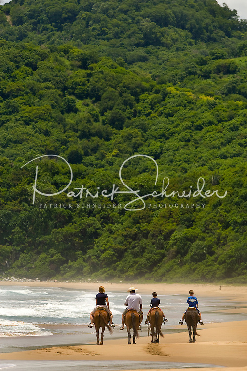 A family of American travelers enjoy riding horses on the beach in Zihuatanejo/Ixtapa.  PHOTOS BY: PATRICK SCHNEIDER PHOTO.COM
