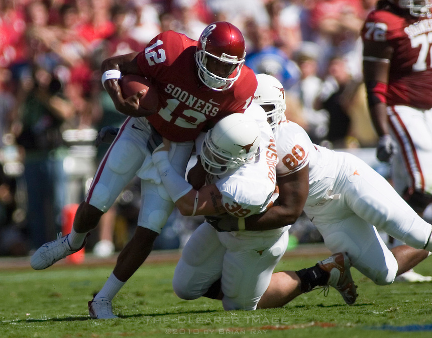 07 October 2006: Oklahoma quarterback Paul Thompson (#12) is sacked for a 13-yard loss by Texas defenders Brian Robison (#39) and Tim Crowder (#80) during the Sooners game against the University of Texas Longhorns at the Cotton Bowl in Dallas, TX.