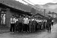 School children receive army training, marching in campus in Yunnan, China. All children are given army training for a week in the summer to toughen them up. July 1999<br /> <br /> photo by Richard Jones / Sinopix