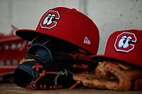 Chattanooga Lookouts hats and gloves in the dugout during a Southern League game against the Birmingham Barons on May 2, 2019 at Regions Field in Birmingham, Alabama.  Birmingham defeated Chattanooga 4-2.  (Mike Janes/Four Seam Images)