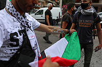 Pictured: A man with a Gaza slogan on his arm holds a Palestine flag in Athens, Greece. Saturday 15 May 2021<br /> Re: Palestinian people living in Greece, joined by local supporters protesting against Israel, have clashed with police in central Athens, Greece.