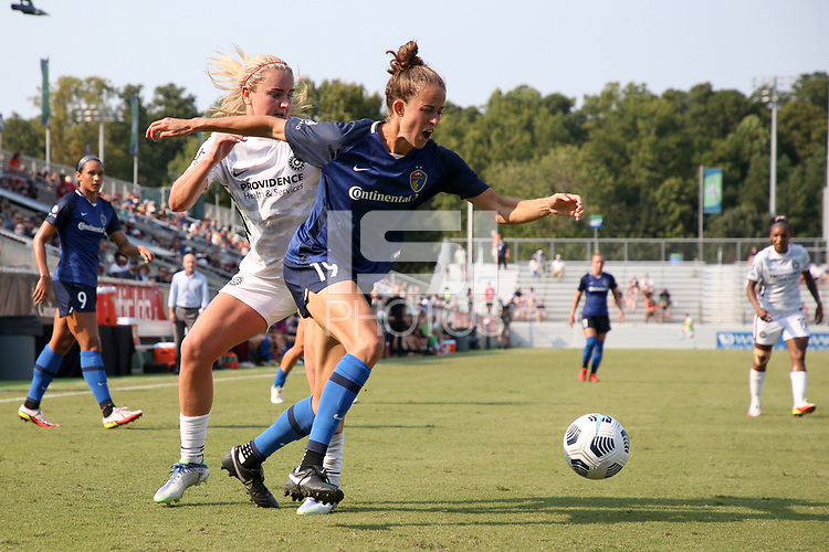 CARY, NC - SEPTEMBER 12: Havana Solaun #19 of the North Carolina Courage fights through a challenge by Lindsey Horan #10 of the Portland Thorns FC during a game between Portland Thorns FC and North Carolina Courage at Sahlen's Stadium at WakeMed Soccer Park on September 12, 2021 in Cary, North Carolina.