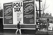 Advertising hoarding announcing the Conservative government's introduction of the Poll Tax and changes to Housing Benefit, Southwark, London.