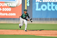 Greensboro Grasshoppers shortstop Liover Peguero (10) tosses the ball to second base to start the front end of a double play during a game against the Asheville Tourists on August 24, 2021 at McCormick Field in Asheville, NC. (Tony Farlow/Four Seam Images)