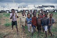 - children in front of vehicles of the Italians Alpini mountain troops in UN peace mission ....- bambini davanti agli automezzi degli alpini italiani in missione di pace ONU