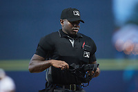 Home plate umpire Tre Jester works the game between the Charleston RiverDogs and the Kannapolis Cannon Ballers at Atrium Health Ballpark on June 29, 2021 in Kannapolis, North Carolina. (Brian Westerholt/Four Seam Images)