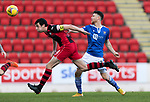 St Johnstone v St Mirren…16.01.21   McDiarmid Park     SPFL<br />Joe Shaughnessy gets to a cross ahead of Guy Melamed<br />Picture by Graeme Hart.<br />Copyright Perthshire Picture Agency<br />Tel: 01738 623350  Mobile: 07990 594431