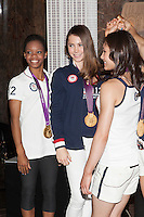 Gabby Douglas, McKayla Maroney and Kyla Ross of The gold medal-winning US Women's Gymnastics Team, the 'Fierce 5', flip the switch and light the Empire State Building's world-famous tower lights red, white and blue in honor of Team USA's success at the 2012 Olympic Game  in London. New York City, August 14, 2012. © Diego Corredor/MediaPunch Inc. /NortePhoto.com<br />