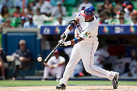 7 March 2009:  #24 Robinson Cano of the Dominican Republic makes contact during the 2009 World Baseball Classic Pool D match at Hiram Bithorn Stadium in San Juan, Puerto Rico. Netherlands pulled off a huge upset in their World Baseball Classic opener with a 3-2 victory over Dominican Republic.