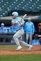Josh Ladowski (12) of the North Carolina Tar Heels follows through on his swing against the Boston College Eagles in Game Five of the 2017 ACC Baseball Championship at Louisville Slugger Field on May 25, 2017 in Louisville, Kentucky. The Tar Heels defeated the Eagles 10-0 in a game called after 7 innings by the Mercy Rule. (Brian Westerholt/Four Seam Images)