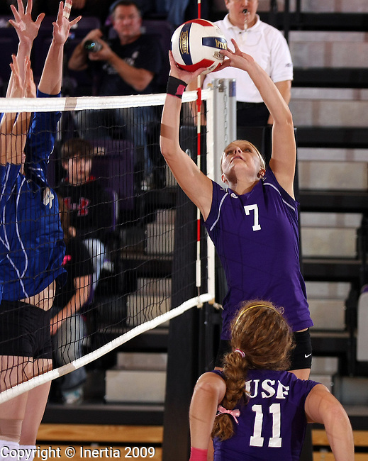SIOUX FALLS, SD - OCTOBER 30: Amber Sneller #7 of the University of Sioux Falls sets the ball to a teammate against Dakota Wesleyan in the first game of their match Friday night at the Stewart Center. (Photo by Dave Eggen/Inertia).