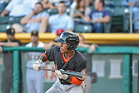 Tony Kemp (6) of the Fresno Grizzlies squares to bunt against the Salt Lake Bees in Pacific Coast League action at Smith's Ballpark on June 13, 2015 in Salt Lake City, Utah.  (Stephen Smith/Four Seam Images)