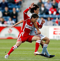 Chicago Fire midfielder Logan Pause (7) and FC Dallas midfielder Pablo Ricchetti (6) get tangled up while going for the ball.  FC Dallas defeated the Chicago Fire 2-1 at Toyota Park in Bridgeview, IL on May 17, 2007.