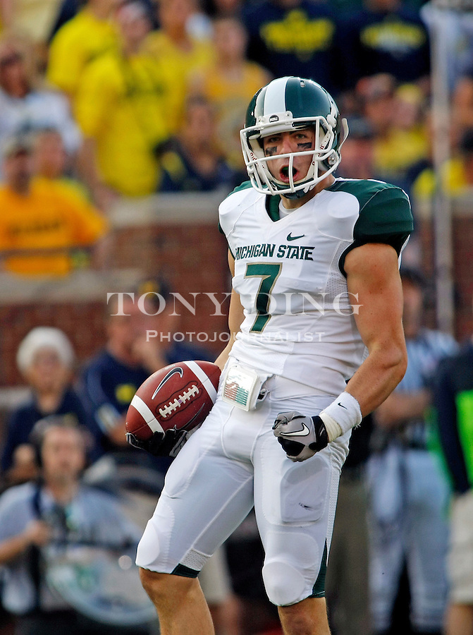 Michigan State wide receiver Keith Nichol (7) celebrates after making a 42 yard catch in the third quarter of an NCAA college football game with Michigan, Saturday, Oct. 9, 2010, in Ann Arbor. Michigan State scored on the drive and won the game 34-17. (AP Photo/Tony Ding)